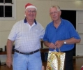 David Walker, vice-president, presents a gift on behalf of band members, to Allan Shaw, president, at the Christmas Function, 18th December 2013