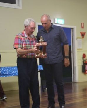 Jack Leckie receives the Jim Adams Encouragement Perpetual Trophy from musical director Dave Thompson. 14 December 2016.